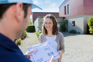 Delivery man handing over a registered letter