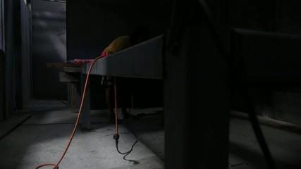 Migrant Welder Welding Metal at Factory Workshop. Slow Motion.