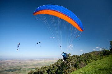 Group of paragliders in flight