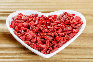 Goji berries in the shape of a heart