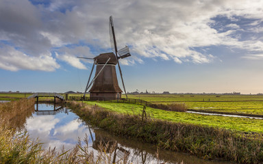 Dutch windmill in polder