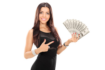 Woman pointing towards a stack of money