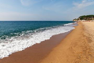 Splashing wave on Calella beach, Spain.