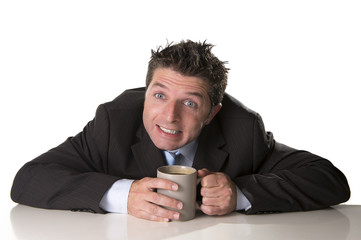 addict businessman holding cup of coffee in caffeine addiction