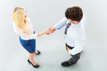 Businessman shaking hands with a businesswoman