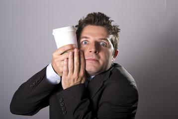 maniac caffeine addict businessman holding take away coffee