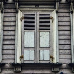 old timber window with closed shutters in riga latvia