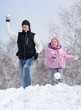 Happy family playing snowball