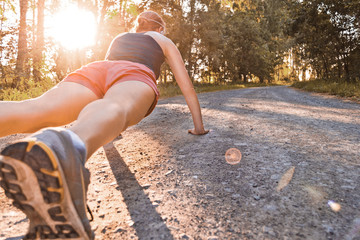 Young sport woman does pushups