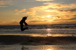 girl jump in front of sea sunset