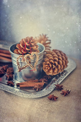 Winter vintage christmas decoration with cones and straw hearts