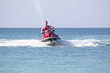 Young guy cruising on the caribbean sea on a jet ski - 71042301