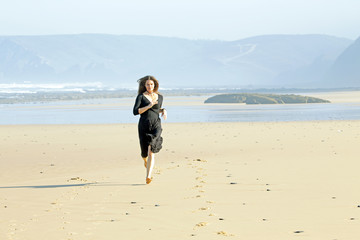Beautiful woman running at the beach