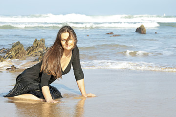 Beautiful woman in the water from the ocean