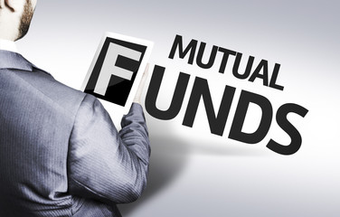 Business man with the text Mutual Funds in a concept image