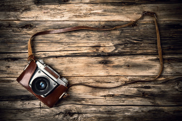 Old photo camera on wood