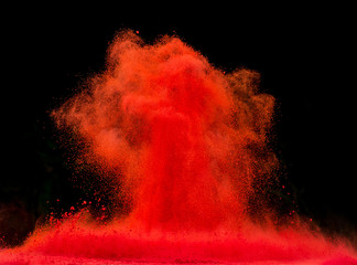 Red dust explosion isolated on black background