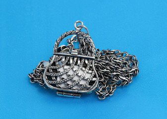 silver pendant in the form of handbags with chain