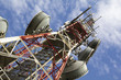Leinwanddruck Bild - Telecommunications tower against blue sky