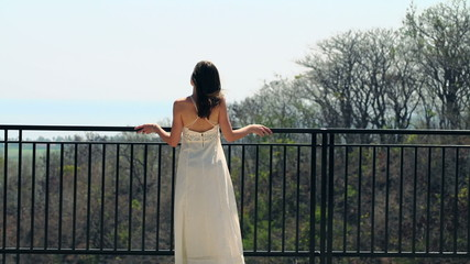 Woman admire beautiful view from terrace