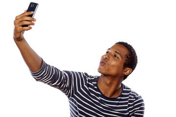 dark-skinned young gay making selfie on white background