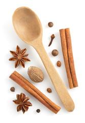 cinnamon sticks, anise star and nutmeg on white