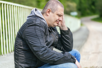 Depressed man on the bridge at outdoors