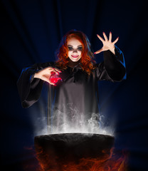 Witch with red potion on blue rays background