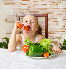 Little smiling girl with vegetables