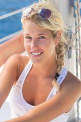 young beautiful woman at a sailing boat