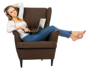 Young girl listen music on chair