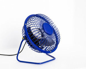 Isolated portable blue mini table fan on white