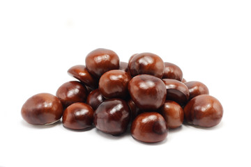 a few brown chestnuts on white background