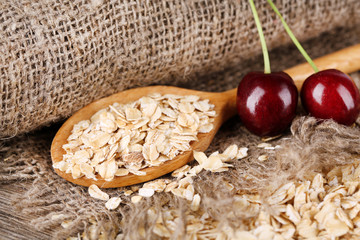 Oatmeal scattered on sackcloth background