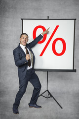 happy businessman predicts an increase in interest rates