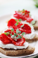 Canapes of cheese and sundried tomato