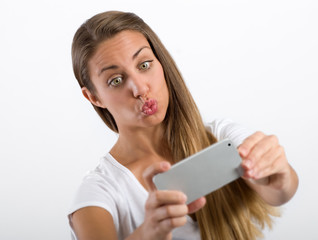 Young woman puckering up for a selfie