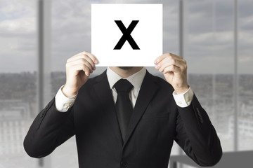 businessman hiding face behind sign crossed out