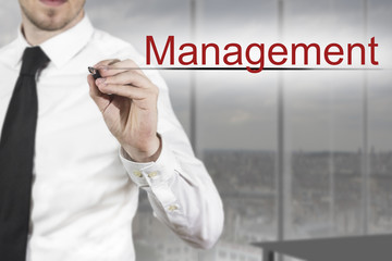 businessman writing management in the air