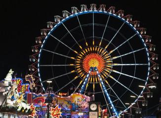 famous ferris wheelat the oktoberfest in munich - germany