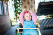 Laughing little girl on swing