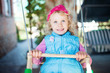 Laughing child on swing