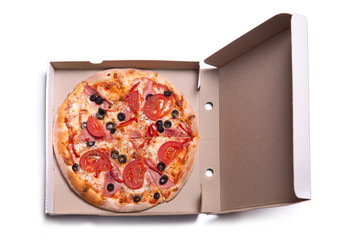 Delicious pizza with ham and tomatoes in box