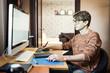 Постер, плакат: Young man at home using a computer freelance developer or desig
