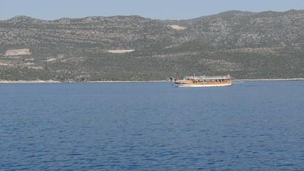 The sink city Kekova and yacht with tourists, Antalya, Turkey