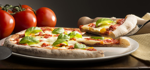 Pizza on the table with ingredients