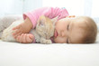 Baby and cat sleeping together - 71054746