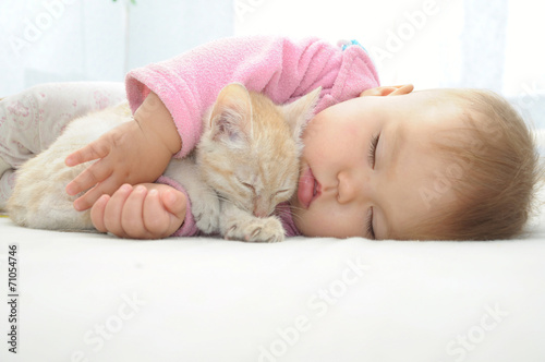 Baby and cat sleeping together