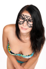 cute brunette woman in swimsuit and mask