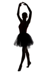 Silhouette of dancer girl with hands up